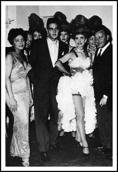 While attending a show at The Moulin Rouge, Elvis accepted the star of the show's invitation to please meet him backstage afterwards. Nancy Holloway is an American singer who was very popular in France around the time Elvis was there (and in the 60′s as well).