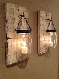 Rustic barn wood mason jar candle holders. Would be great outdoors hanging on a fence.