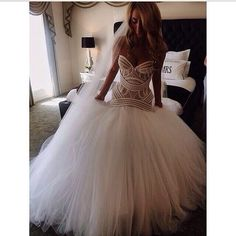 Perfect dress..beautiful feminine top half, and amazing princess style fluffy bottom