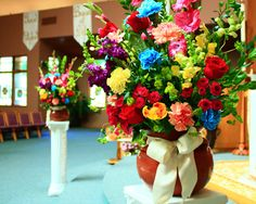 Cinco de Mayo wedding by Flowerful Designs! Absolutely BEAUTIFUL, vibrant flowers adorn the church alter.