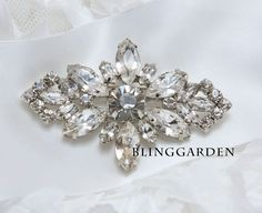 A pair of Glass Rhinestone Crystal White Feather by blinggarden, $26.99