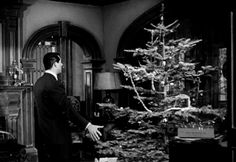 "myrna-au-go-go: "" Cary Grant trims the tree. """