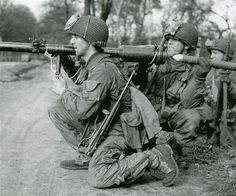 US airborne soldiers in Europe - photo by Robert Capa - The weapon is a bazooka, an extremely effective anti tank device