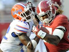 Alabama running back Derrick Henry (27) is forced out of bounds by Florida's Keanu Neal (42) at Bryant Denny Stadium in Tuscaloosa, Ala. on Saturday September 20,  2014.