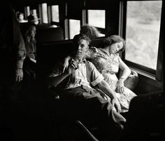 """Two of some 300 West Virginians recruited by the Farm Security Administration to travel to Upstate New York for the fall harvest of peaches, apples, tomatoes and other crops, part of a """"Food for Victory"""" campaign occasioned by the wartime manpower shortage. Sept 1942. """"High school boys and girls going by special train from Richwood, West Virginia, to upper New York state to help bring in the harvest."""" Photo by John Collier for the Farm Security Administration ~"""