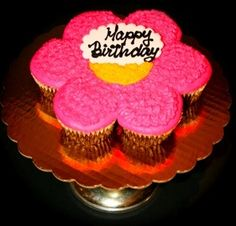 Cupcake Flower Cake, This is cool not so much for a boy but girls yes and even grown up's...