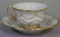 19TH C. MEISSEN CUP AND SAUCERS