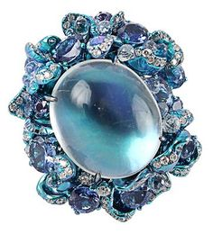 Blue moonstone ring by Arunashi. Moonstone, diamonds and sapphires.