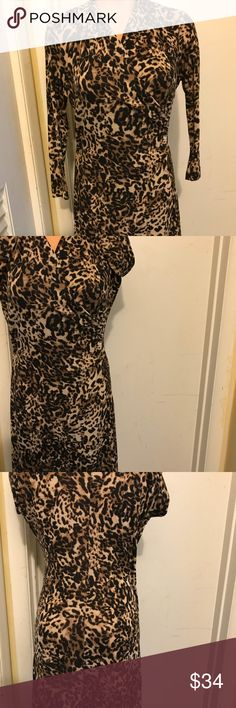 Kasper Ladies Leopard Cheetah Faux Wrap Dress (M) This pre-owned beautiful dress will cause heads to turn.  Everyone loves a Leopard Print dress, its stylish and very classy.  This dress has a V-neck, 3/4 Quarter Length sleeves and is 97% Polyester and 3% Spandex.  The material is a stretch knit.  I wear a size 10/12 and it fits me perfectly.  I've only worn it on a  couple of occasions.  Downsizing my closet. Kasper Dresses Long Sleeve