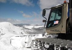 A snowcat heads out for a powder skiing day with Vail Powder Guides
