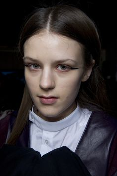 Paula Gerbase - Hair and make-up... Elongated cats eye flicks that started at the end of the lid and super dewy skin. Hair was classically Paula simple middle partings. Just like us Topshop girls wear everyday! #NEWGEN