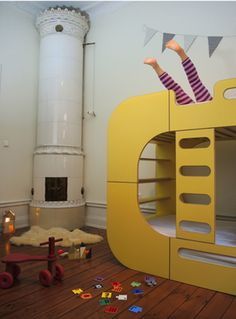That yellow bunk bed against dark wood floor and the tile fire, simply gorgeous, children bedroom design
