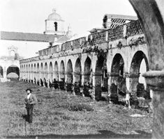 Exterior view of the Mission San Luis Rey de Francia looking from the west arch and taken by photographer Edward Vischer, San Diego, before 1875 :: California Historical Society Collection, 1860-1960