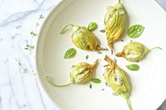 baked squash blossoms with pine nut cheese via Dolly and Oatmeal
