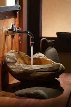 Really like including organic materials like this stone sink. Too bad those items tend to be out of our price range. Sink Design, Bathroom Sink Design