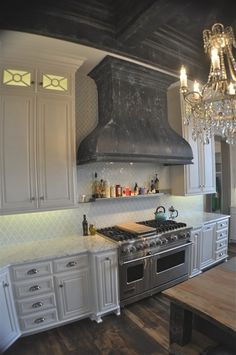 Look at Hood???  Modern Masters Metal Effects on a range hood and coffered ceiling by Tom Henman of Tom Henman Decorative Painting of Lancaster, PA