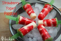 Grab the kids and have them help you make these easy and delicious Strawberry and Yogurt Popsicles. So easy, so fun, and so perfect for a hot day!