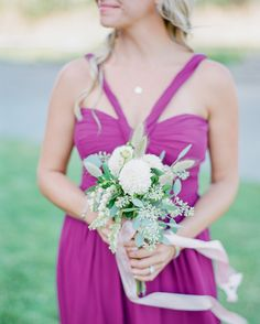 To complement the bridesmaids' dark pink dresses, florist Darci Greenwood of Beargrass Gardens paired three white dahlias with seeded eucalyptus, pieris japonica, and bunny tail grass and tied them all together with  light pink silk ribbon.