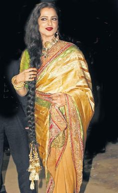 Rekha in Rajya Sabha draped in a yellow silk saree and carrying a golden handbag. #Bollywood #Fashion #Style