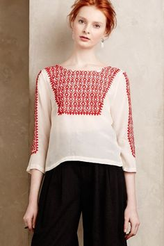 Chepi Tie-Back Blouse - anthropologie.com. Pretty red bows at back. This model is creeping me out!