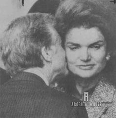 Jimmy Carter kissing Jackie Kennedy in 1979