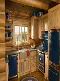 I do not like the interior of this cabin :( This kitchen is way too small and has ugly blue cabinets.