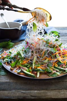 An incredible recipe for Vietnamese Vermicelli Salad w/ Sweet Chili Vinaigrette & Roasted peanuts - bursting with flavor and healthy and light! | www.feastingathom...