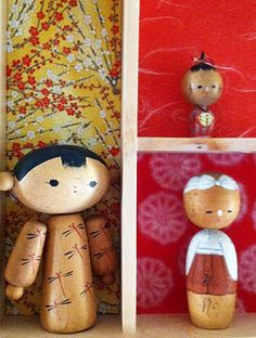 Get a shadow box and line it with washi papers for a kokeshi doll display