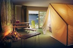 Basecamp Hotel - South Lake Tahoe, CA - Both kids and adults will go nuts for this hip, affordable, inn-like spot in South Lake Tahoe, and for good reason: You'll find forest wallpaper, fake campfires, tented beds, Coleman-style lanterns, steel bunk beds and… Xboxes.
