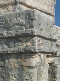 Face carved into the side of a building. Tulum, Mexcio