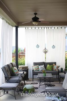 How to make your own diy outdoor curtains and secure them so they won't blow away in the wind.