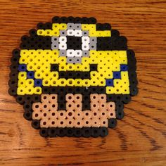 This is a listing for one perler bead minion mario mushroom. All of the beads are evenly ironed and fused together. This was 100% made by myself.