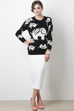 Complete your fall wardrobe with the Elephant Daze Sweater. This long sleeve sweater features a round ribbed neckline, soft stretch knit, topped with elephant print