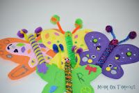 Butterfly Craft with foam sheets, Popsicle sticks, pompoms, stickers and pipe cleaners