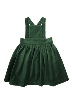 Our 2nd Edition Pinafore in Velvet Forest is sure to make a statement this winter. Criss cross strap closure with 2 wooden buttons. **Laundry instructions: Wash on delicate cycle and hang dry. Do NOT