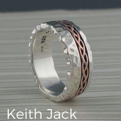 Hammered Celtic Weave Wedding Ring by Keith Jack. Continuous off center 10K Rose Gold Celtic Weave Design on Sterling Silver Ring. 8 mm wide and stamped .925 (Sterling Silver).   Antiqued black background polished design & hammered edges.