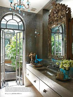Glam bathroom with glass mosaic tiles, Italian Opaline glass chandelier, French silver leaf mirror, Opaline glassware and cherub.