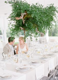 Spectacular hanging floral display of branches and greenery by The Savage Garden. Image by Buffy Dekmar, styling by Ginny Branch. #wedding