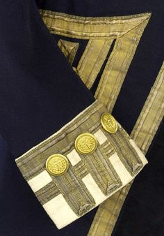 Detail of the trim on the rear admiral's coat.
