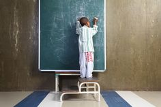 Young black boy in pyjamas - hospital patient drawing on blackboard in hospital paediatric ward - Dscovery project Young Black, Black Boys, Pediatrics, Pyjamas, Discovery, Africa, Medical, Drawing, Learning