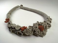 Taupe and vintage gold crochet necklace with flower, via Flickr.