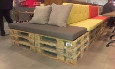 Amazing what you can do with a few old #pallets and a #futon or two! Spotted at the #IMM Furniture Show in Koln.