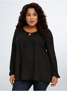 """<p>Update your status to lattice; this blouse will definitely be your most """"liked"""" look. Black georgette (a teensy bit see-through) is solid in the front with a small keyhole neck. The real thing that will be blowing up your style timeline is the skin-baring lattice back.</p>  <p></p>  <p><b>Model is 5'10"""", size 1</b></p>  <ul> <li>Size 1 measures 30 1/2"""" from shoulder</li> <li>Polyester</li> <li>Hand wash cold, dry flat</li> <li>Imported plus size blouse..."""