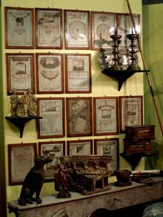 Beautiful antiques from Mercanteinfiera, Parma Italy, collection of items in sepia tones in identical frames above table or mantle form charming vignette inspiration