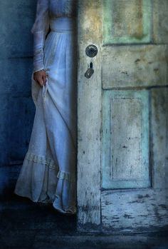 Lady in Vintage Clothing Hiding Behind Old Door.  Fine Art Print - Jill Battaglia.