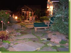 Here's an idea for a flat stone patio, gaps between stones filled with ground cover