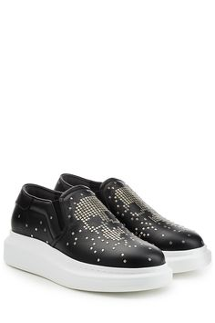 Embellished with silver-tone studs that form the brand's signature skull motif, these black platform slip-on sneakers from Alexander McQueen will elevate your urban city uniform in an instant * Black leather, silver-tone studs, round toe, elasticated insert, leather insole and rubber sole * White platform * Wear them with a black tee and slim denim | Men