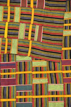 Africa | Detail; 'Kente' from the Ewe people of Ghana | Cotton; narrow strip loom | Mid 20th century | Partial view
