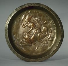 Plate with Wife Beating Husband, ca. 1480 Netherlandish (Dinant or Malines) Brass, beaten; Diam. 20 in. (50.8 cm) Gift of Irwin Untermyer, 1964 (64.101.1499)