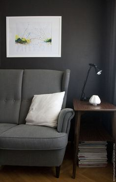 dark grey black living room with grey ikea strandmon sofa mid century modern